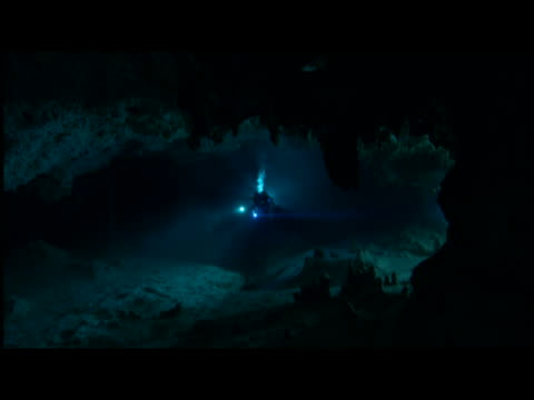 ms scuba diver exploring underwater cave - stalagmite stock videos and b-roll footage