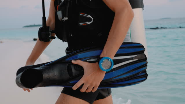 scuba diver walking along a beach at sunset close up on fins - aqualung diving equipment stock videos & royalty-free footage