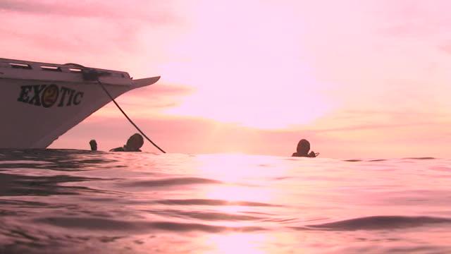 Scuba Divers at Sunset