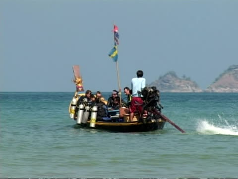 ms scuba divers on boat moving out to sea, phuket, thailand - tauchgerät stock-videos und b-roll-filmmaterial