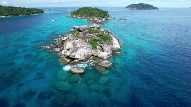 scuba diving boats visit the pristine waters of the similan islands, thailand - david ewing stock videos & royalty-free footage