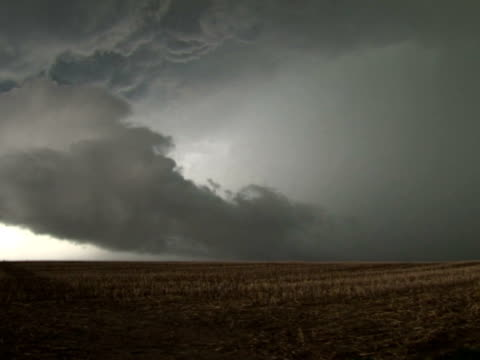 Scud cloud under large storm clouds, WA, USA