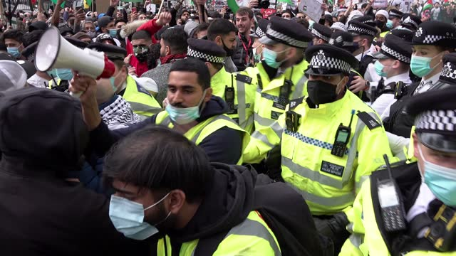 scuffles brake out as police intervene to prevent pro-palestinian protestors from confronting a small group of pro-israeli counter protestors on a... - tail light stock videos & royalty-free footage