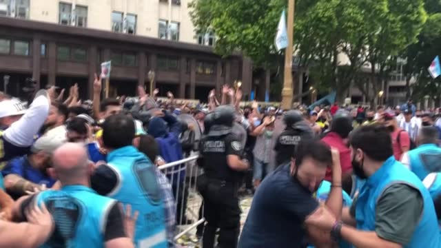 scuffles erupt between police and distraught fans desperate to access argentina's presidential palace where the body of football legend diego antonio... - problems stock videos & royalty-free footage