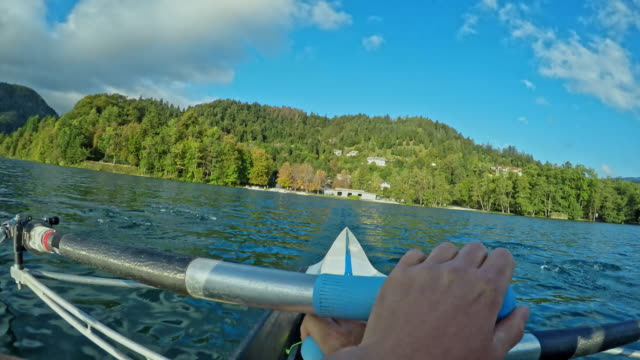 pov sculler propelling the boat on a sunny lake - sculling stock videos & royalty-free footage