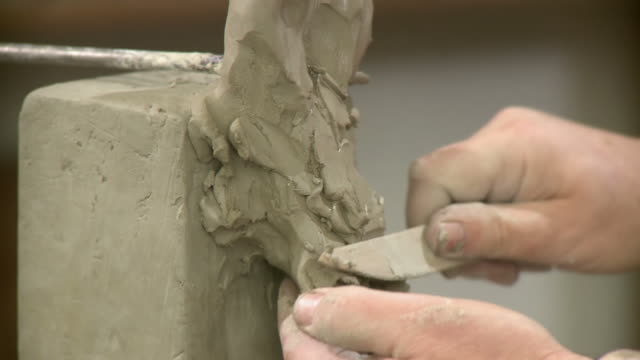 HD DOLLY: Sculptor Artist Hands Modeling Clay