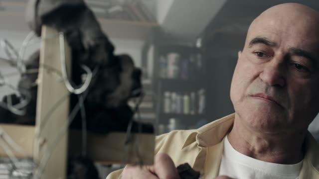 sculptor creates a clay sculpture - active seniors stock videos & royalty-free footage