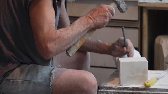 sculptor creating a sculpture - mallet hand tool stock videos and b-roll footage