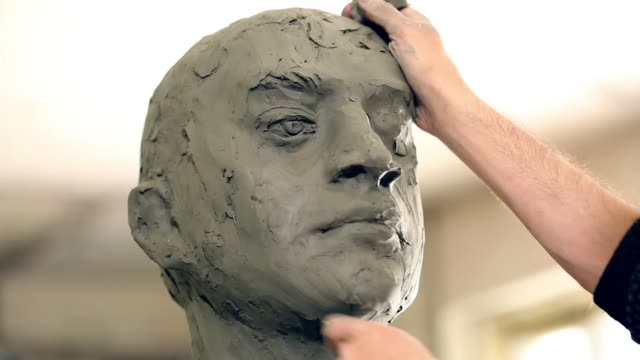 sculptor is working on the creation of a monument - one mid adult man only stock videos & royalty-free footage