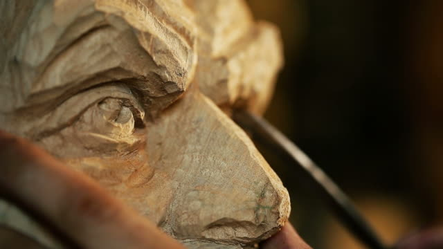 sculptor working with wooden statue and carving wood - wood texture stock videos and b-roll footage