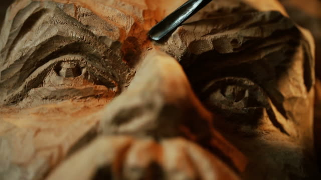 sculptor working with wooden statue and carving wood - male likeness stock videos & royalty-free footage