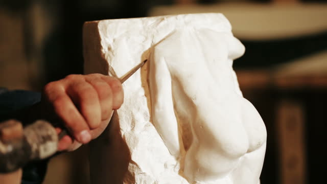 sculptor works with marble statuette - marmorgestein stock-videos und b-roll-filmmaterial