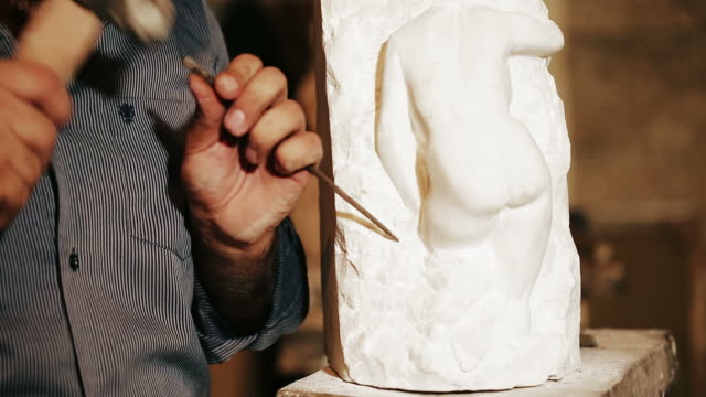 sculptor works with marble statuette - bust sculpture stock videos and b-roll footage
