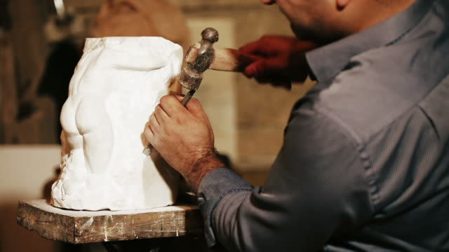 sculptor works with marble statuette - chisel stock videos and b-roll footage