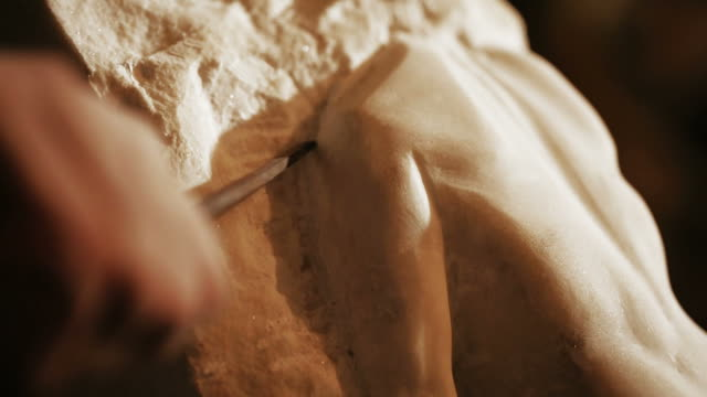 sculptor works with marble statuette - marble stock videos & royalty-free footage