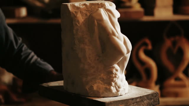 sculptor works with marble statuette - weibliche figur stock-videos und b-roll-filmmaterial
