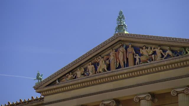 la sculptural pediment of the philadelphia museum of art / philadelphia, pennsylvania, united states - pediment stock videos & royalty-free footage