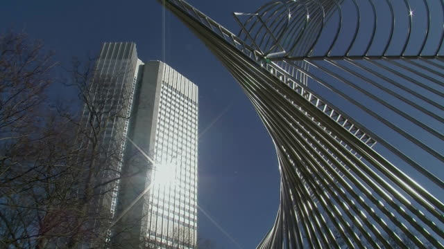 WS LA Sculpture and European Central Bank against blue sky / Frankfurt, Hessen, Germany