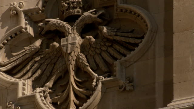 a sculpture of a double-headed eagle spreads its wings in bas relief. available in hd. - bas relief stock videos & royalty-free footage