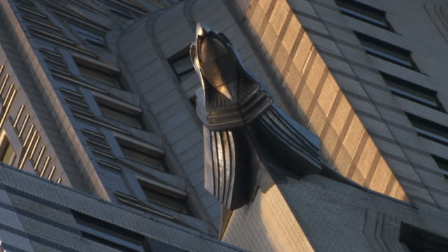 cu la canted sculpture of eagle on top of chrysler building / new york city, new york, usa - chrysler building stock videos and b-roll footage