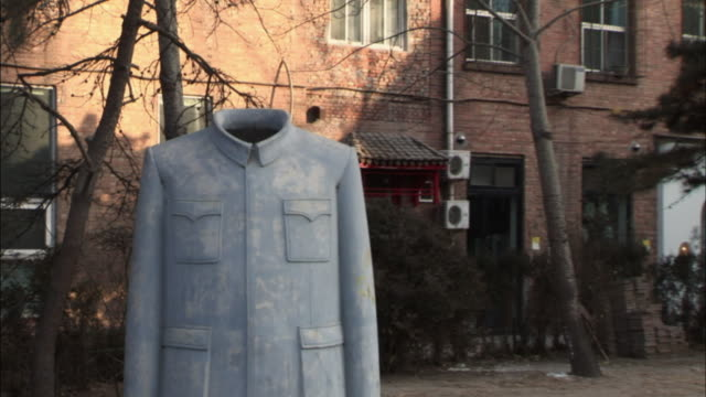ms sculpture of grey military jacket on side of residential street/ zo ws street and sculpture/ beijing, china - unknown gender stock videos & royalty-free footage