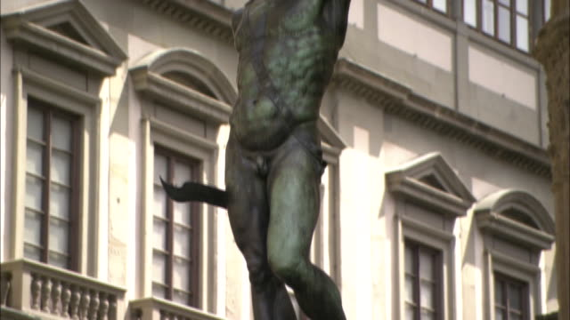 a sculpture of perseus and medusa stands near a hotel in florence, italy. - sculpture stock videos & royalty-free footage