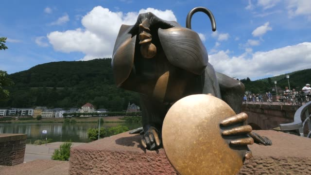 sculpture of the bridge monkey at bridge gate, neckar river, heidelberg, baden-wurttemberg, germany, europe - neckar river stock videos & royalty-free footage