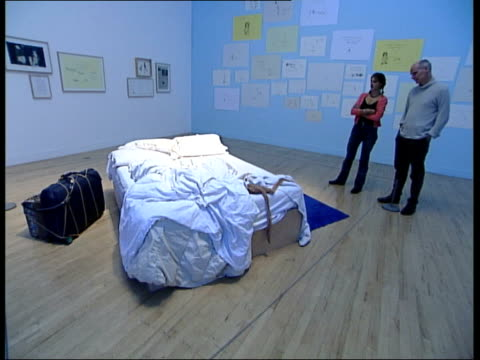 Turner Prize Tracey Emin interview Tracey Emin interview SOT discusses her 'bed' installation as walking around it with reporter Nicholas Glass/...