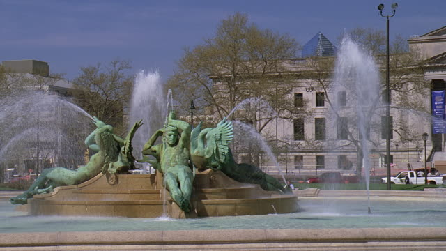 pan sculptures in fountain spraying in front of philadelphia museum of art / philadelphia, pennsylvania, united states - swann memorial fountain stock videos & royalty-free footage