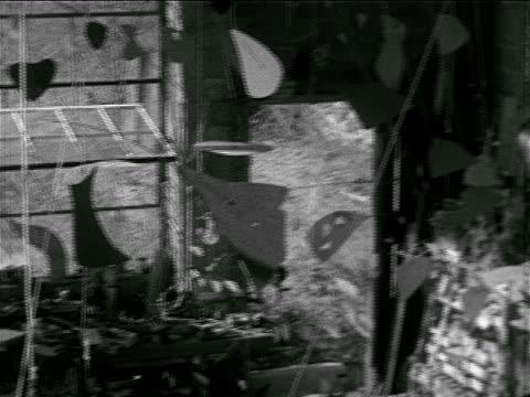 sculptures, mobiles hanging in studio, american sculptor kinetic artist alexander 'sandy' calder cutting sheet metal w/ tin snips, studio, vs tools,... - 1898 stock videos & royalty-free footage