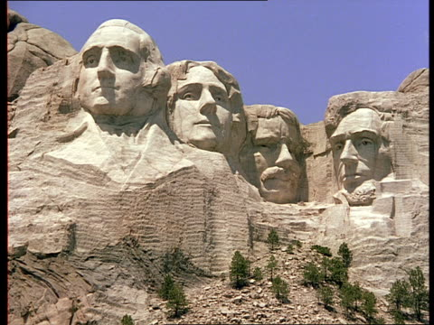 sculptures of four former united states presidents cover mount rushmore in south dakota. - mt rushmore national monument stock videos and b-roll footage