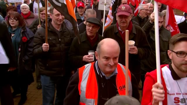 scunthorpe march in support of steelworkers england scunthorpe ext protesters with banners and placards for unite and 'save our steel' marching /... - marching stock videos and b-roll footage
