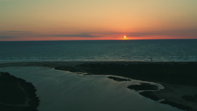 sea and estuary at sunset, lower rio grande valley - estuary stock videos & royalty-free footage