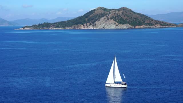 sea and pine tree. blue voyage. - marmaris stock videos & royalty-free footage