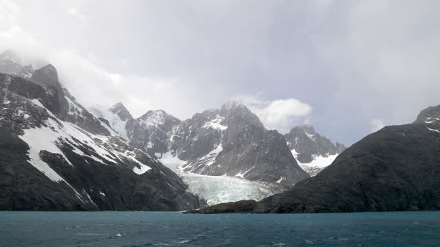 sea and rocky mountains with snow - south georgia island stock videos & royalty-free footage