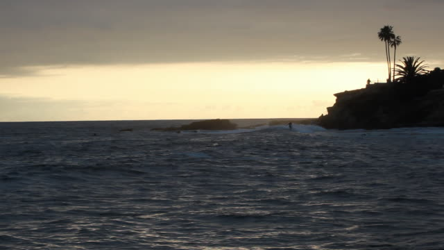 ws sea at sunset, laguna beach, california, usa - laguna beach california stock videos & royalty-free footage