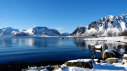 sea at the fjord and the nothern mountains covered with the snow at the Lofoten archipelago, nothern Norway
