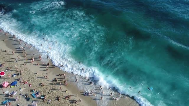 Sea beach full of people aerial footage