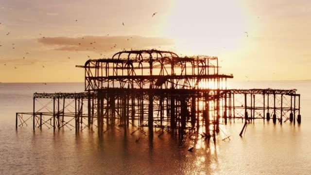 sea birds roosting on west pier ruins - 1975 stock videos & royalty-free footage