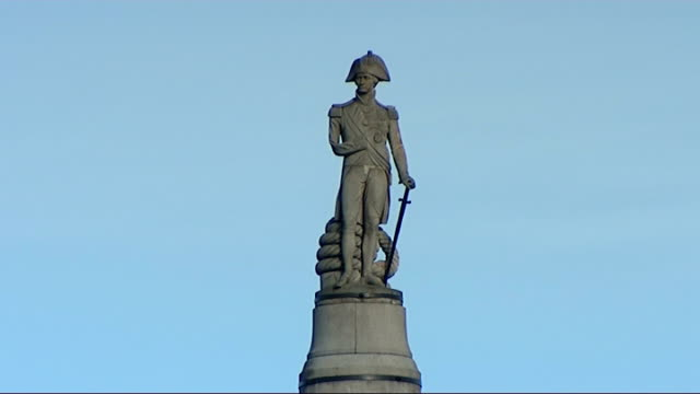 sea cadets mark anniversary of battle of trafalgar statue of admiral horatio nelson on nelson's column silhouette of nelson's column against cloudy... - admiral nelson stock videos and b-roll footage
