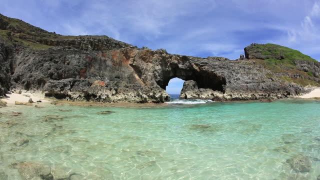 ms sea cave and coral sand beach of minami jima island, desert island of unesco world natural heritage ogasawara islands / ogasawara islands, tokyo, japan - desert island stock videos & royalty-free footage