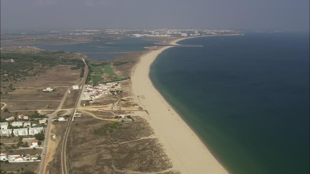 AERIAL WS Sea coast with sandy beach / Alvor, Faro, Portugal
