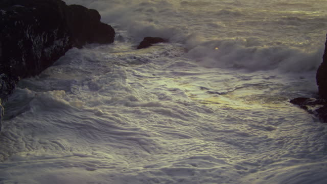 WS TU ZI SLO MO Sea foam and splashing waves in Pacific Ocean / Newport, Oregon, USA