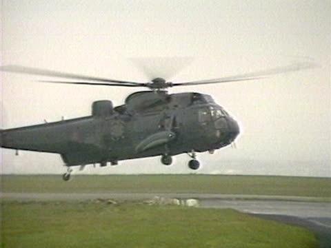 stockvideo's en b-roll-footage met a sea king rescue helicopter returns to its base after aiding the zeebrugge ferry disaster rescue mission - ramp veerboot zeebrugge 1987