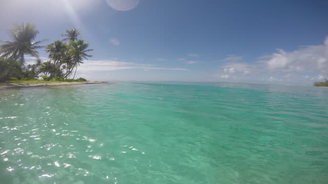 sea, lagoon in front of an island with trees - tahitian culture stock videos & royalty-free footage