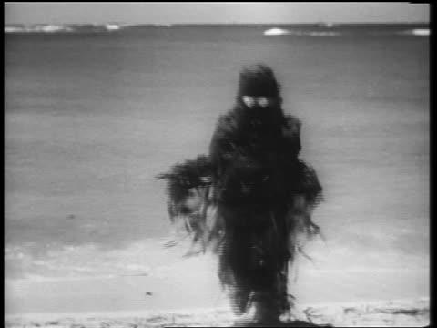 b/w 1961 sea monster walking out of ocean onto beach toward camera - モンスター点の映像素材/bロール