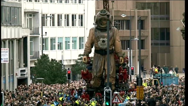 sea odyssey street theatre event in liverpool england liverpool ext **music heard sot** general views of giant puppets involved in 'sea odyssey'... - puppet stock videos & royalty-free footage