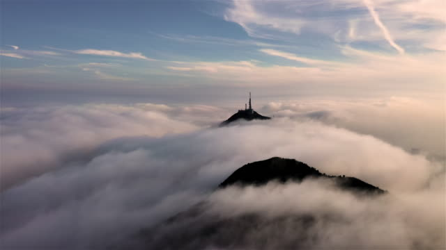 sea of clouds and a broadcasting tower protruding through in hong kong - hong kong stock videos & royalty-free footage