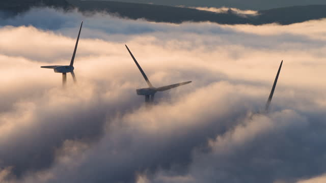 vídeos y material grabado en eventos de stock de sea of clouds and windmills, wind farm or wind park, portillo de la sia, soba valley - las merindades, valles pasiegos, burgos - cantabria, spain, europe - fog