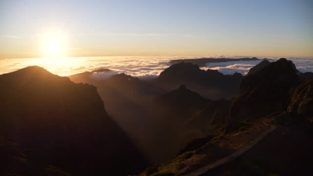 Sea of clouds at sunset with mountains seen from Pico do Arieiro (mountain). Pico do Arieiro, Madeira Island, Portugal